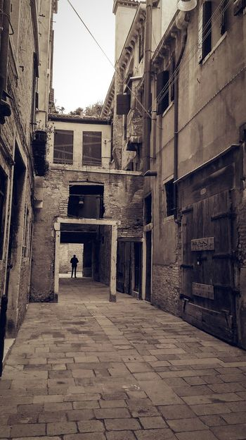 Wanderlust Wander Wandering Around Aimlessly Wandering Lost In Thought... Lost Lost In Time Venice, Italy Venice Venice Street Concrete Jungle Floating City Man Architecture Built Structure Building Exterior City Outdoors Day People One Person Sky Only Men