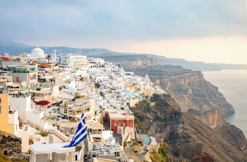 Greece Santorini Oia Thira Architecture Building Exterior Built Structure Mountain Sky Building City Nature Residential District High Angle View Day Town No People Outdoors Cloud - Sky House Cityscape Community TOWNSCAPE