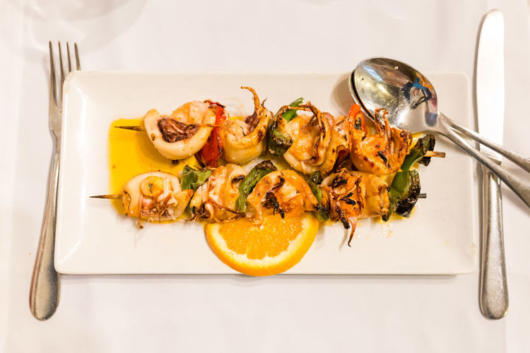 Traditional portuguese dish: Espetada de Lulas e Gambas (skewer with squid and king prawns) Dishes Espetada Food Dish Portugal Portuguese Seafood Skewer Tatstylesmash Food Food And Drink Healthy Eating High Angle View No People Ocean Portuguese Food Prawns Ready-to-eat Restaurant Serving Size Squid Traditional Wellbeing