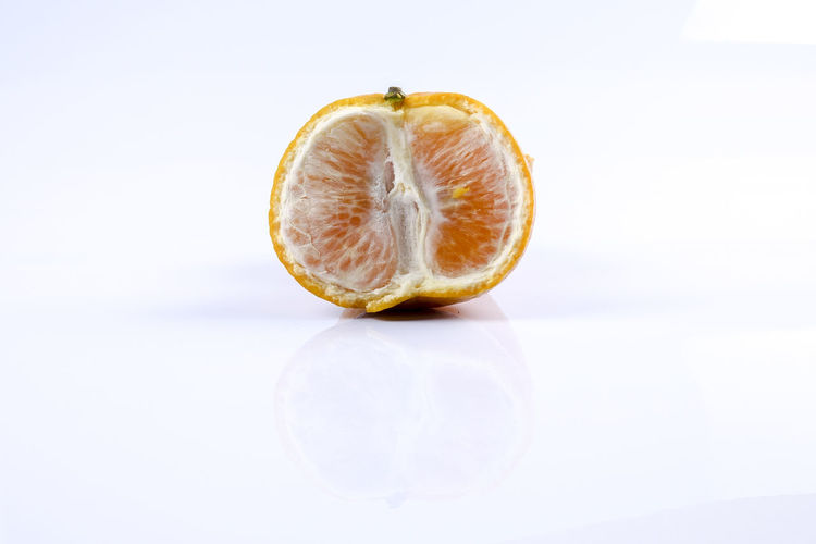 MANDARIN ORANGES ISOLATED ON WHITE Mandarin Oranges New Year Chinese New Year Close-up Food Food And Drink Freshness Fruit Healthy Eating Indoors  No People Studio Shot Wellbeing White Background