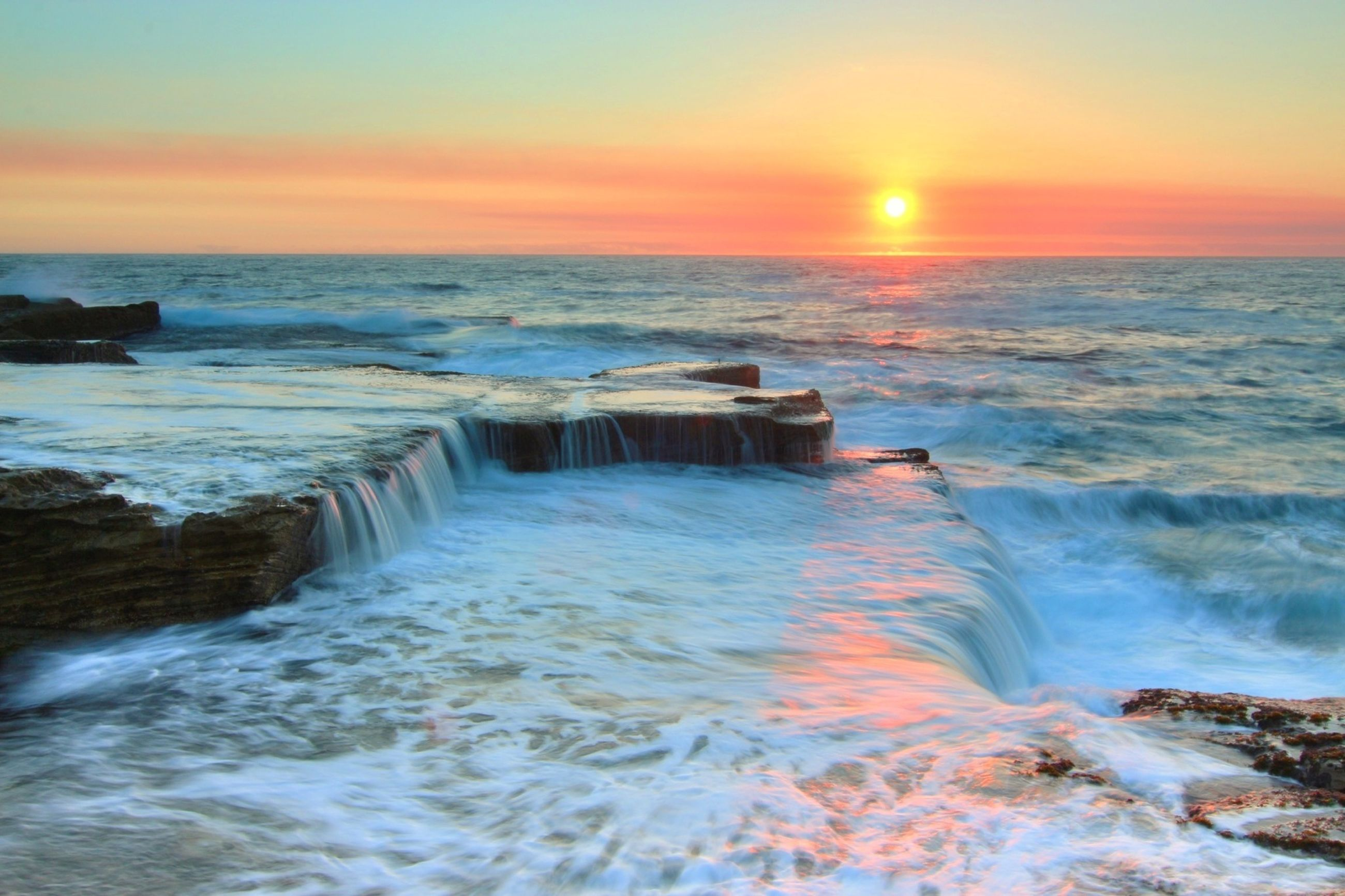 water, sea, sunset, scenics, horizon over water, beauty in nature, wave, motion, tranquil scene, surf, sky, rock - object, nature, orange color, idyllic, tranquility, beach, rock formation, long exposure, shore