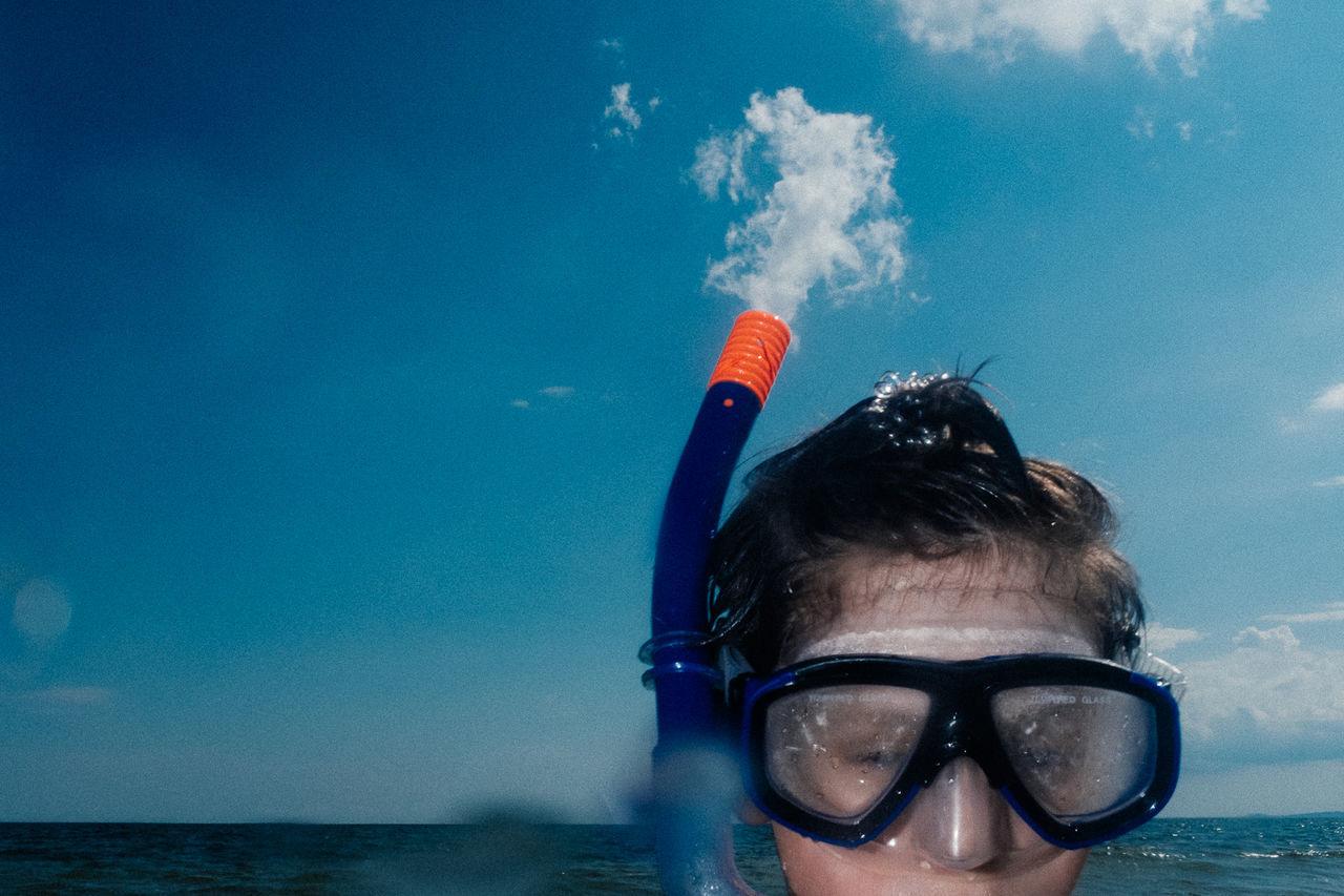 water, one person, sea, sky, real people, portrait, leisure activity, headshot, lifestyles, nature, cloud - sky, adventure, day, blue, men, aquatic sport, underwater, swimming, outdoors, snorkeling, eyewear