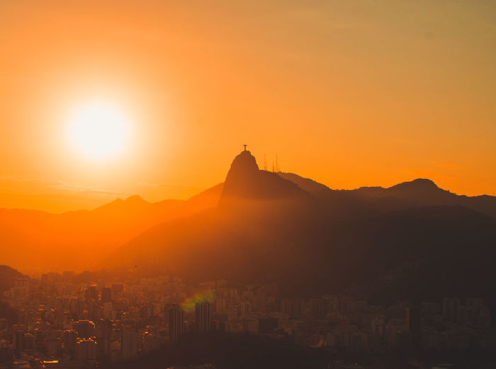 Amazing sunset from sugerloaf mountain, with a view on Christ the Redeemer, Rio de Janeiro, Brazil Building Exterior Architecture Sky Sunset City Built Structure Cityscape Orange Color Silhouette Building Mountain Nature Sunlight Sun Travel Destinations Landscape Beauty In Nature Outdoors Scenics - Nature Travel No People Christ The Redeemer Rio De Janeiro Sugerloaf Mountain Brazil