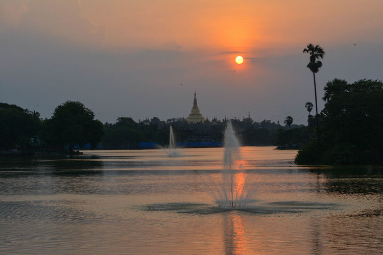 View of fountain at temple during sunset