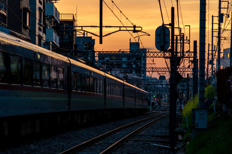 Tokyo Tokyo,Japan Architecture Building Exterior Built Structure Cable City Day Electricity Pylon Mode Of Transport No People Outdoors Power Line  Public Transportation Rail Transportation Railroad Track Sky Sunset Train - Vehicle Transportation