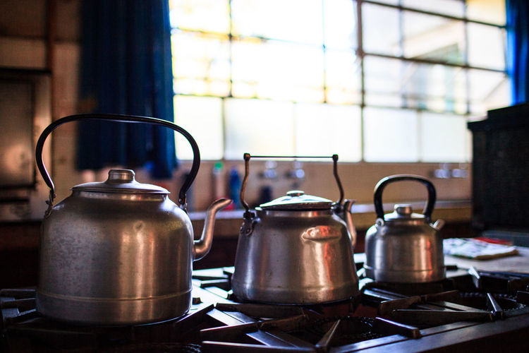 Close-Up Of Kettles In Kitchen