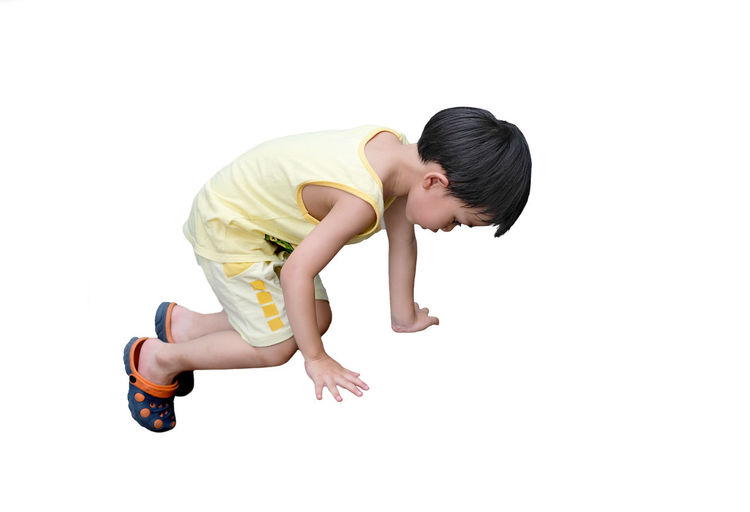 Side View Of Boy Against White Background