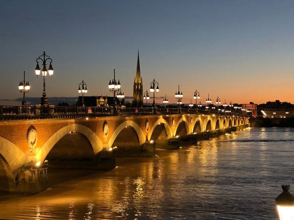 Pont de pierre EyeEmNewHere Architecture Water Built Structure Connection Sky Bridge Transportation Bridge - Man Made Structure River Sunset Nature Building Exterior Clear Sky Arch Travel Destinations Arch Bridge No People City Illuminated Waterfront