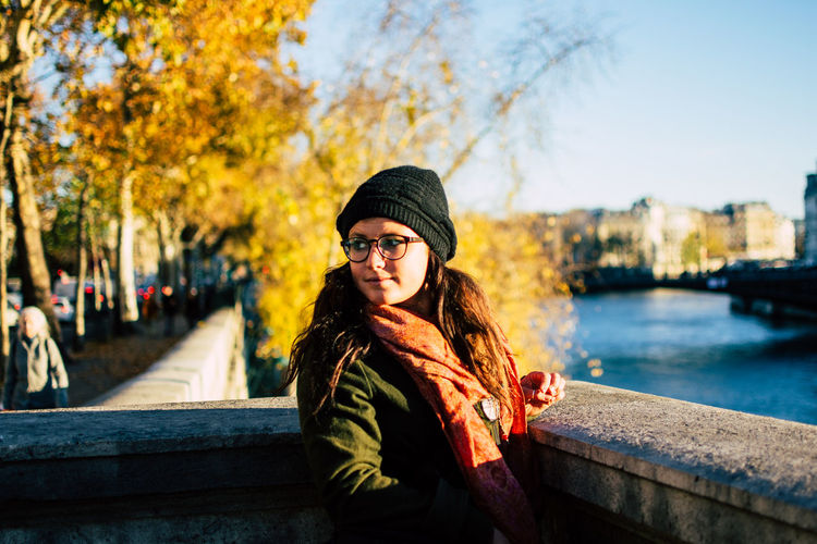 Portrait of beautiful young woman in park during autumn