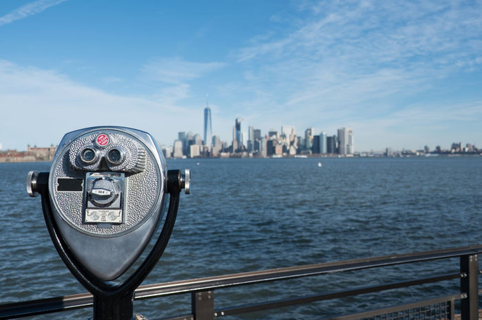 Tower viewer telescope looking at lower Manhattan skyline from Liberty Island. Railing and binoculars on a stand for tourists to view New York City from across the New York Harbor. Ellis Island  Hudson River Hudson River Ny Liberty Island Manhattan Manhattan New York Manhattan Skyline Manhattan, New York City New York City New York City Photos New York Harbor New York Skyline  New York ❤ New York, New York Sightseeing Statue Of Liberty Statue Of Liberty New York Tower Viewer