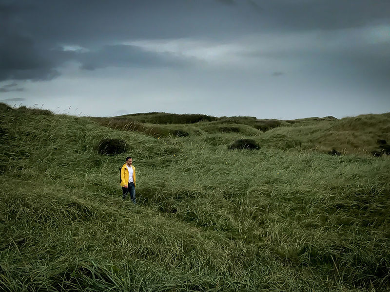 man in dunes Adventure Backpack Beauty In Nature Day Field Full Length Grass Growth Landscape Leisure Activity Lifestyles Men Nature One Person Outdoors People Photographing Real People Rear View Scenics Sky Standing Tranquil Scene Tranquility Lost In The Landscape