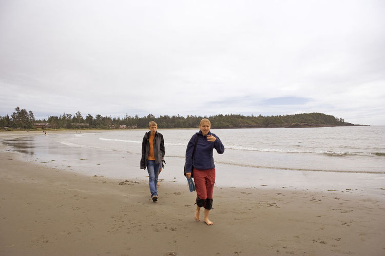 Brother and Sister on Long Beach of Pacific Rim National Park - Vancouver Island, British Columbia, Canada Adventure Attitude Beach Boy And Girl British Columbia Brother & Sister Canada Full Length Hiking Hikingadventures Landscape Leisure Activity Long Beach Pacific Rim National Park People Sand Sea Serious Teen Teenager Togetherness Two People Vacations Vancouver Island Walking