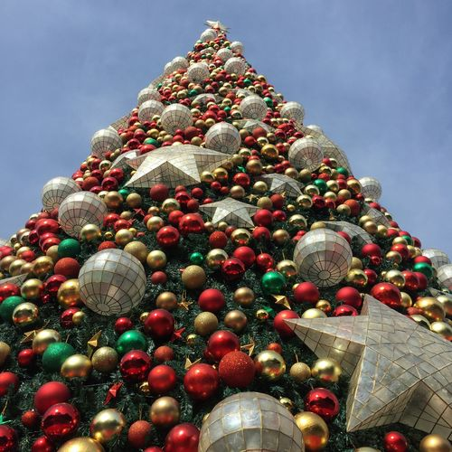 Low angle view of christmas decoration against sky