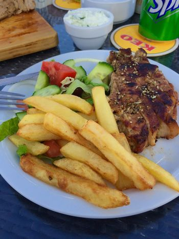 Grilled pork chop French Fries Salad Cypriot Food Serving Size Ready-to-eat Dinner Tonight Food And Drinks The Place I'm Now
