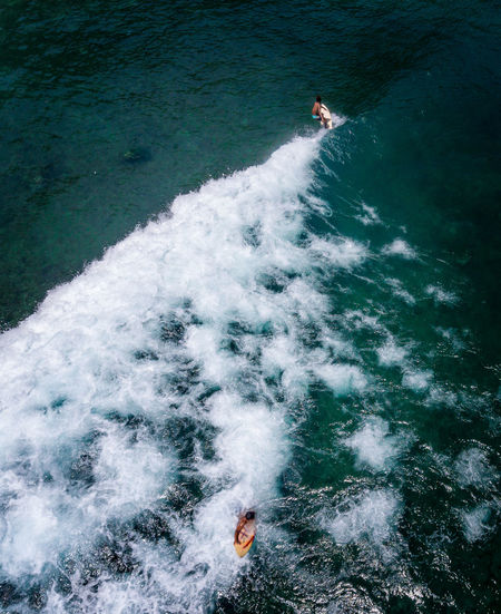 High angle view of people in sea. surfing