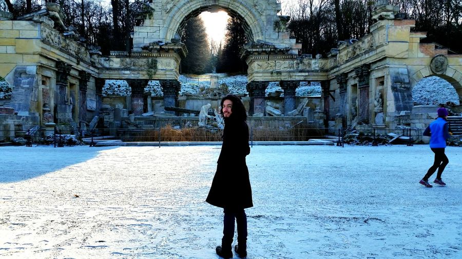 Architecture Built Structure Walking Leisure Activity Outdoors Winter Snow Winter Sun Roman Style January Cold Day Light And Shadow Real People Day Young Adult