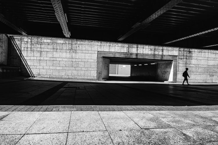 Architecture B&w Photo B&w Street Photography Blackandwhite Built Structure One Person Standing Tunnel Underpass Underpass, EyeEm LOST IN London The Week On EyeEm Postcode Postcards Black And White Friday The Graphic City