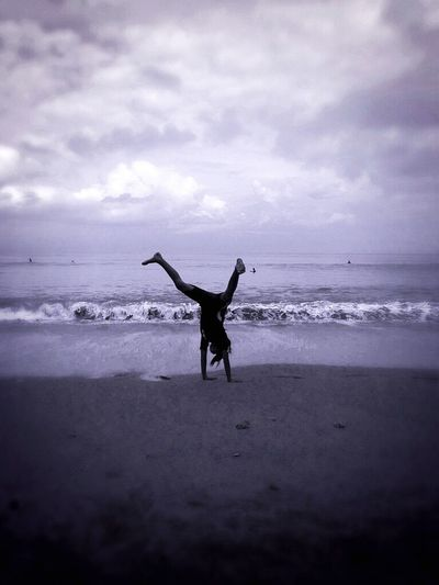 Beach Bali Acrobatics  Fun Family Holiday IPhoneography Daughter Girl Acrobat Blackandwhite Photography Travel Photography Beach Photography Eye4photography  EyeEm Best Shots Girl Doing Handstand Popular People Balancing Elements Capture The Moment Black And White