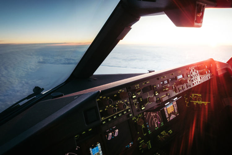 Scenic view of sea seen through airplane window in cockpit