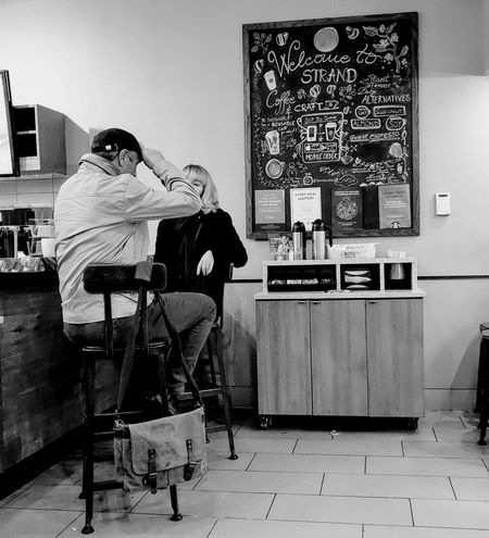 coffee shop Photowalktheworld Black And White Photography People Watching People Photography Candid Photography Candid Shot Film Industry Full Length Men Arts Culture And Entertainment Rear View Friend Personal Perspective Changing Channels Thoughtful Sensuous Posing
