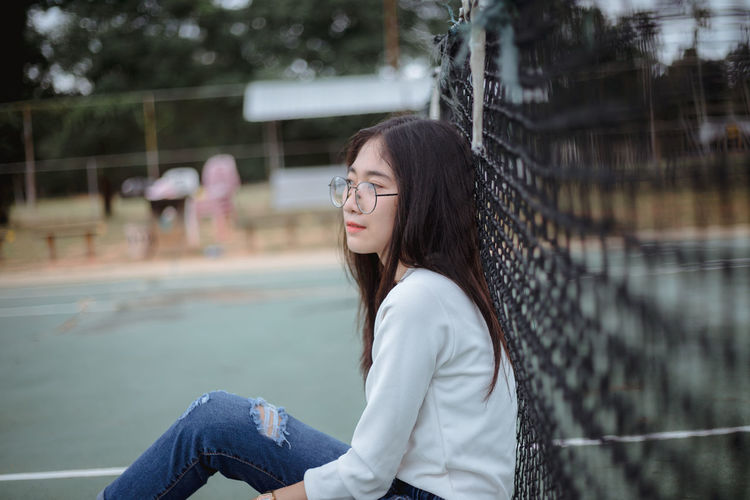 cute girl Beautiful Woman Casual Clothing Contemplation Day Focus On Foreground Hair Hairstyle Leisure Activity Lifestyles Long Hair Looking One Person Outdoors Real People Side View Sitting Teenager Three Quarter Length Young Adult Young Women