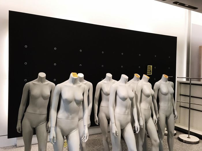 Panoramic view of statues in store