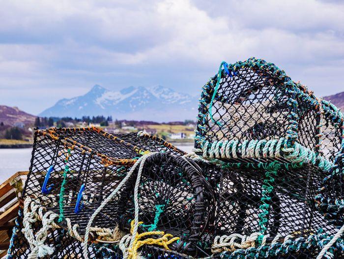 Fishing net on beach against sky