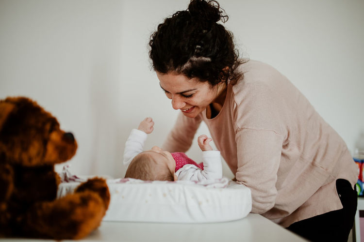 Mother Motherhood Daughter Family With One Child Family Matters Love Togetherness moments of happiness Home Innocence Positive Emotion Mother & Daughter Babyhood Baby Women Indoors  Real People Sitting Females Lifestyles Moms & Dads