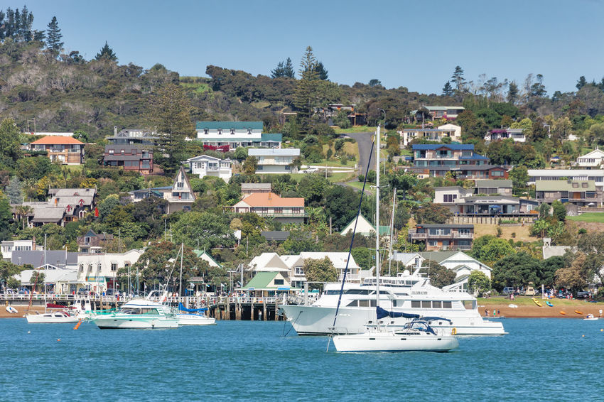 View of Russell in Bay of Islands with residential buildings and boats - Panorama in Northland, North Island, New Zealand Architecture Bay Of Islands Cityscape Coastline Harbor New Zealand Beauty New Zealand Scenery Pier Russell TOWNSCAPE Boats Building Building Exterior Built Structure Hill Nautical Vessel New Zealand North Island People Residential Building Sea Town Water Waterfront Yacht