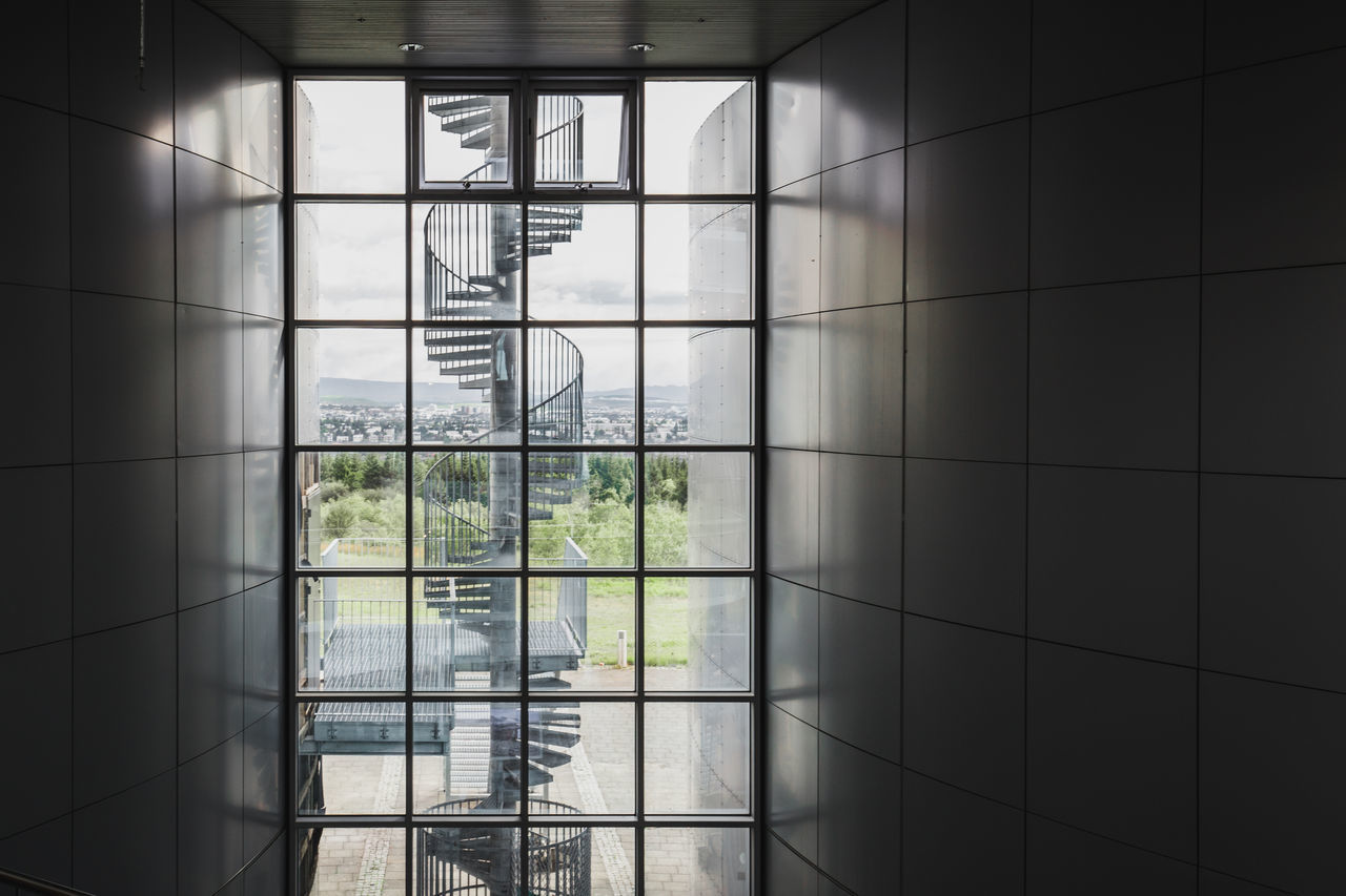 window, glass - material, transparent, indoors, no people, day, architecture, flooring, nature, built structure, pattern, plant, geometric shape, shape, tree, tile, sunlight, reflection, design