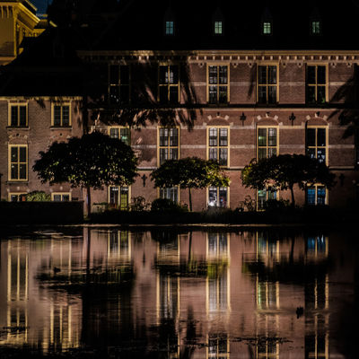 Architecture Building Building Exterior Built Structure City Illuminated Lake Nature Night No People Outdoors Plant Reflection Travel Destinations Tree Water Waterfront Window