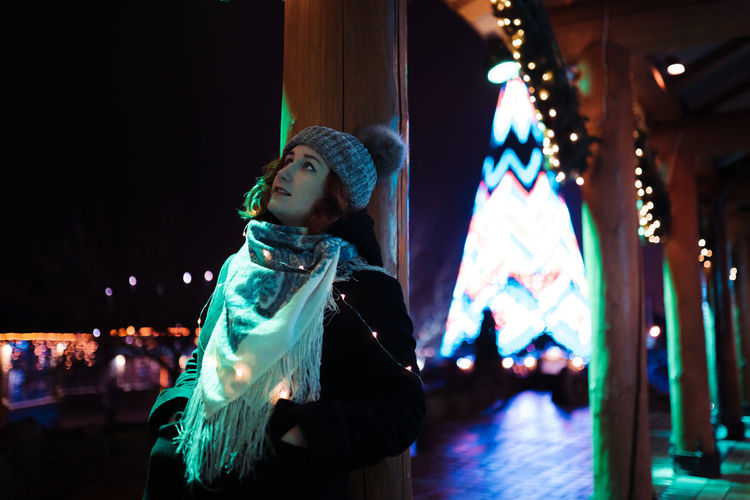 Woman wearing knit hat standing outdoors