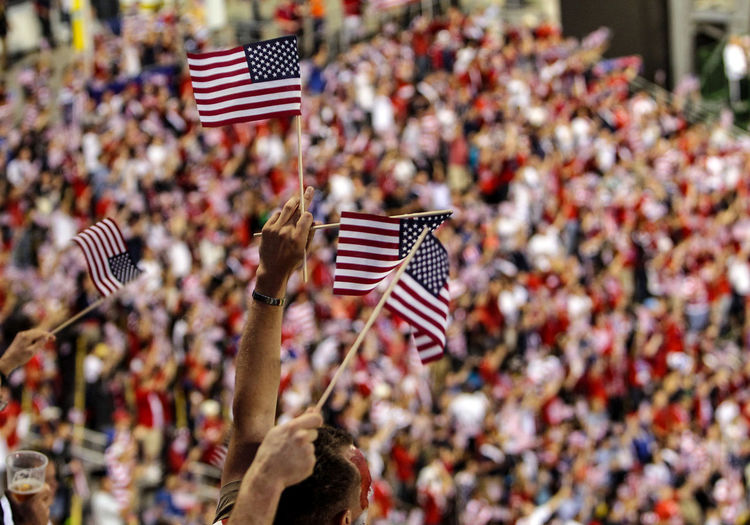 Close-up of american flags against blurred background