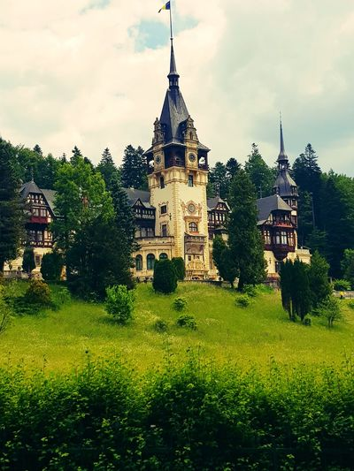 Peles Castle in Romania Palace Castle Castles Castle Tower Tower Royalty Royal Ferdinand King - Royal Person KINGDOM EyeEm Selects Lovely Extraordinary  Close-up Tree City Lawn Sky Architecture Grass Building Exterior Built Structure Historic Royal Person Fort History Historic Building Ancient Queen - Royal Person