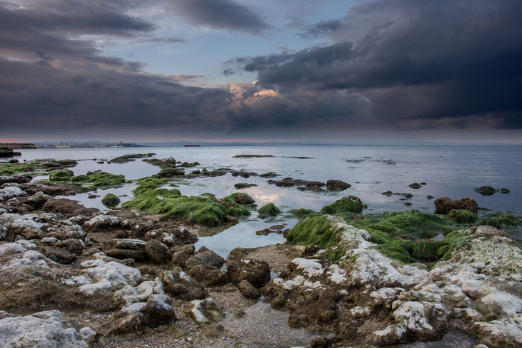 Stones Beach Beauty In Nature Cloud - Sky Day Igniting Landscape Nature No People Outdoors Postcard Rock - Object Scenics Sea Sky Sun Sunset Water