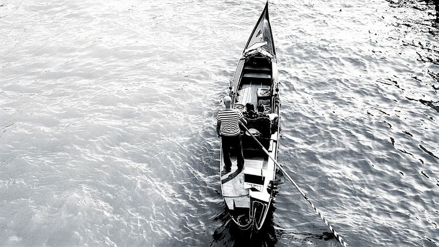 High angle view of man sitting on boat