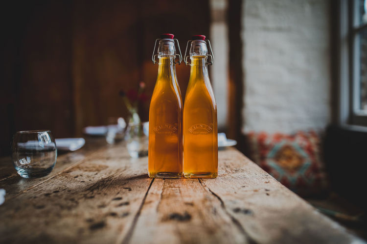 Alcohol Beer Beer - Alcohol Bottle Container Drink Food Food And Drink Freshness Glass Glass - Material Household Equipment Indoors  No People Refreshment Selective Focus Still Life Table Transparent Wood - Material