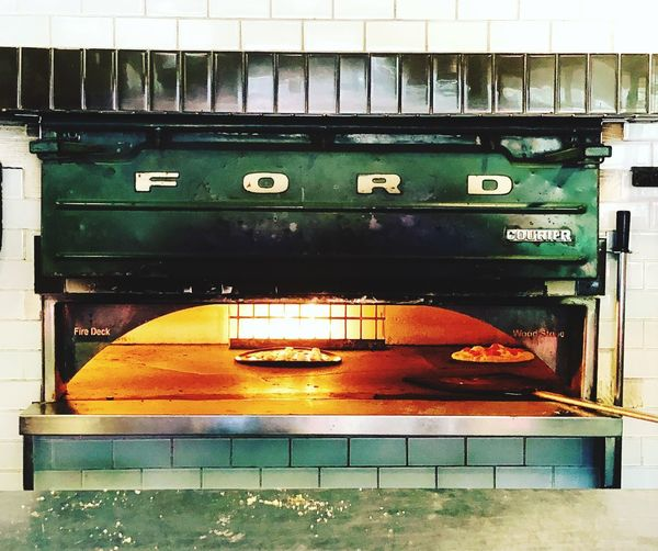 Ford Pizza Oven Cooking No People Built Structure Architecture Auto Post Production Filter Day Close-up Building Exterior Technology Transfer Print Communication Outdoors Old Metal Green Color Wall Industry Heat - Temperature Number Nature Mode Of Transportation
