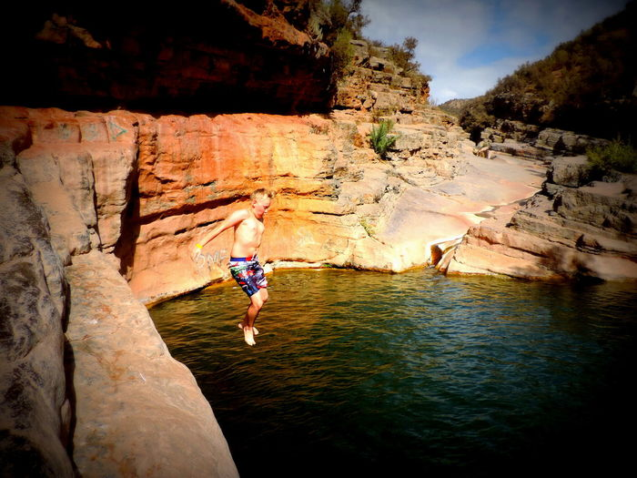 Boy jumping in river