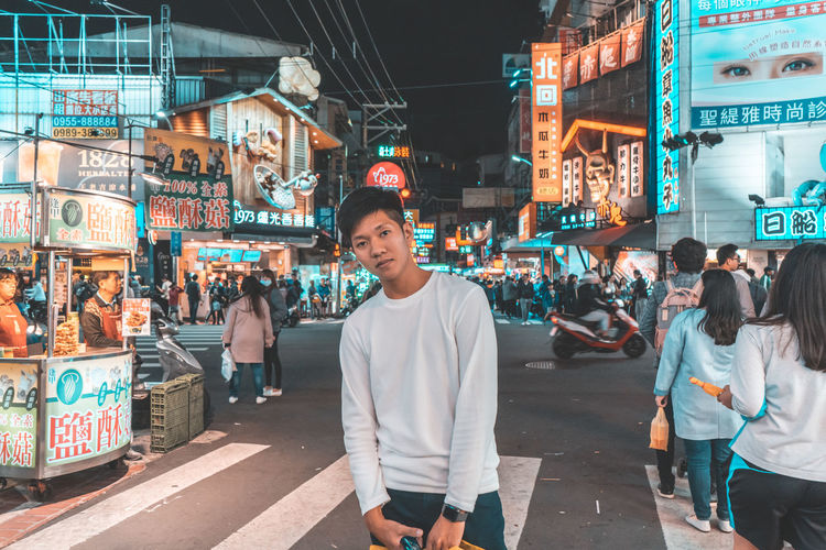 City Real People Illuminated Architecture Men Lifestyles City Life Casual Clothing Retail  Leisure Activity Adult People Group Of People Incidental People Street Market Women Night Young Adult Outdoors