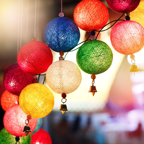 Close-up of lanterns hanging on ceiling
