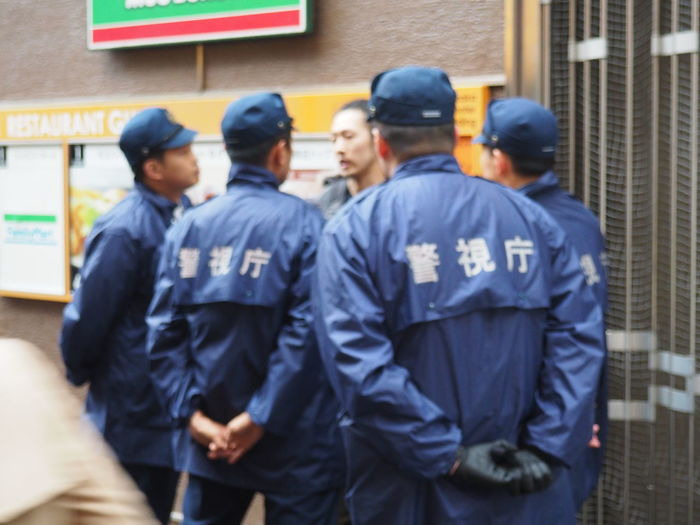 Authority Blue Cooperation Day FTP Headwear In A Row Japan Large Group Of People Men Occupation Outdoors People Police Police Force Police Uniform Real People Rear View Responsibility Standing Teamwork Togetherness Tokyo Trouble Uniform Break The Mold The Street Photographer - 2017 EyeEm Awards BYOPaper!