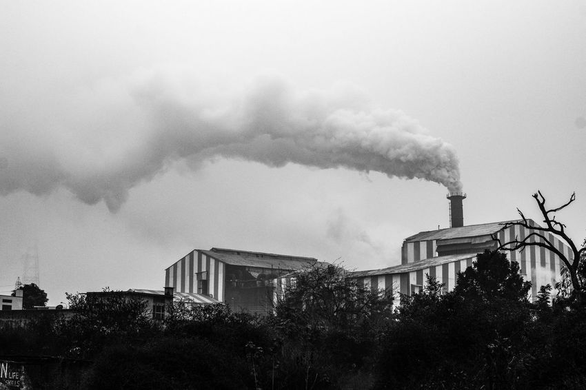 Mind the polluted InMakin! Bnw Blackandwhite Randomness Words Pollution Mind  Pollution Smoke - Physical Structure Built Structure Architecture Factory Smoke Stack Sky Industry Chimney Outdoors Building Exterior Colour Your Horizn