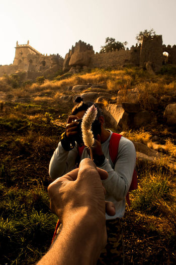 Man photographing friend on location