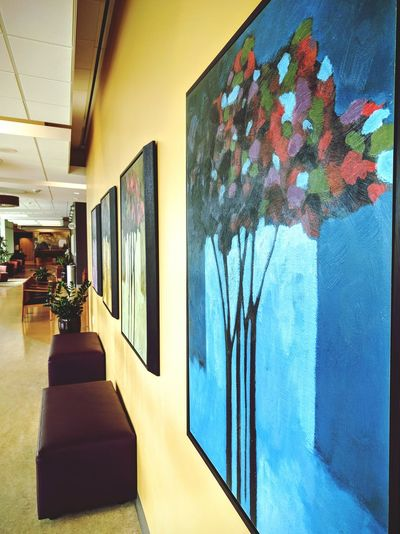 it's strange when both doctor and patient are dealing with colds, lol 😷 Corridor Waiting Area Building Interior No People Mobile Photography Eye Level Decorative Art Doctors Waitng Room Artworks Paintings Focus On The Foreground Looking For Inspiration Down The Hall Close-up
