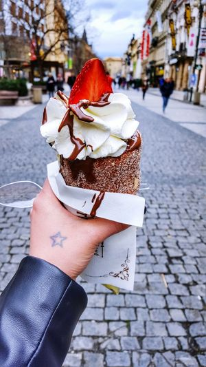 Sweets from prague. City Outdoors City Life Tasty Chocolate Food Porn Food Dessert Travel Photography TravelDay People Holiday Nikonphotography Traveling Prague Czech Republic Human Hand Holding Real People Building Exterior Close-up Lifestyles Vanila Yummi Amazing Food The Street Photographer - 2017 EyeEm Awards Your Ticket To Europe Mix Yourself A Good Time Done That.