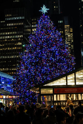 Night time in NYC with a little cheer. Bryant Park  Bryant Park NYC Celebration Christmas Christmas Decoration Christmas Lights Christmas Ornament Christmas Tree Illuminated Midnight New York Night Nightphotography NYC NYC Parks Outdoors Winter Village Winter Village Bryant Park