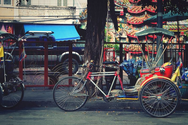 View of bicycles parked on sidewalk