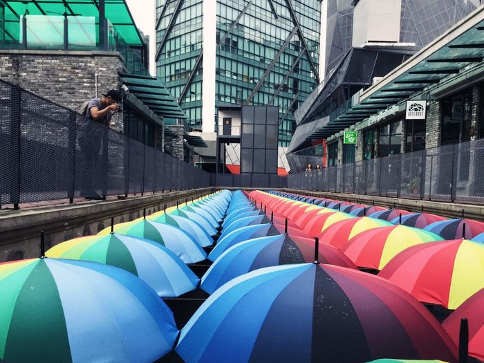 Multi Colored Architecture Built Structure Modern Building Exterior No People Indoors  Futuristic Day Innovation EyeEmNewHere Adult People One Person Leisure Activity Mobile Conversations The Street Photographer - 2017 EyeEm Awards