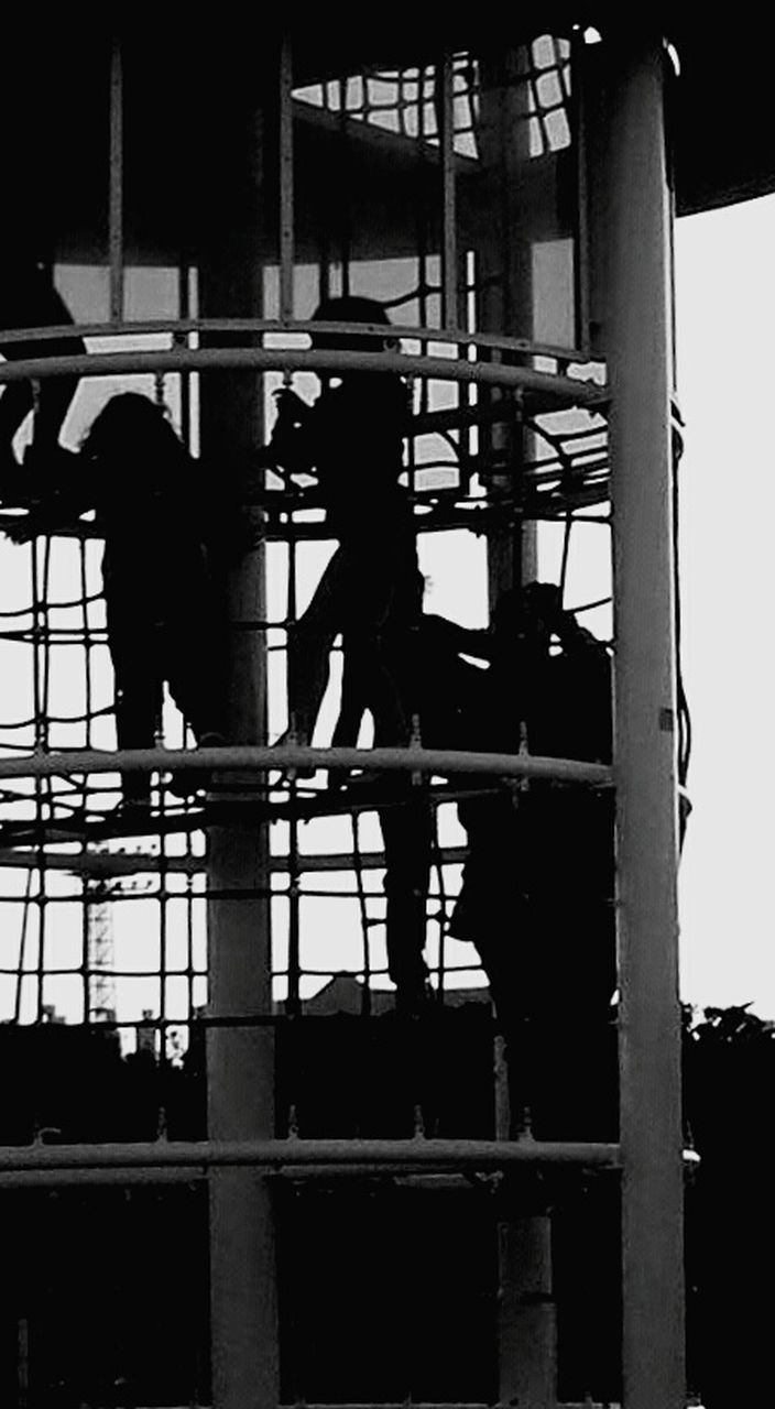 real people, built structure, architecture, day, men, silhouette, full length, outdoors, two people, building exterior, standing, lifestyles, manual worker, occupation, construction worker, working, window washer, sky, adult, people
